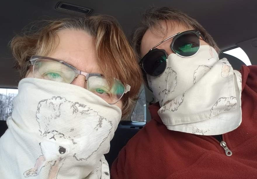 My wife and I wearing easter napkins as face coverings.