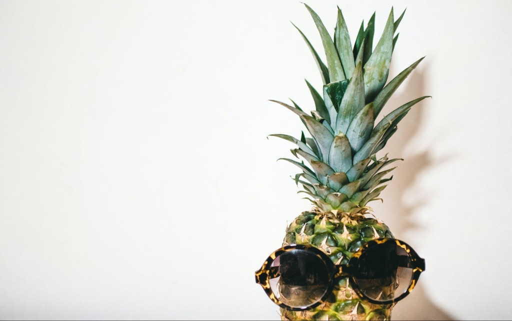 pineapple wearing sun glasses