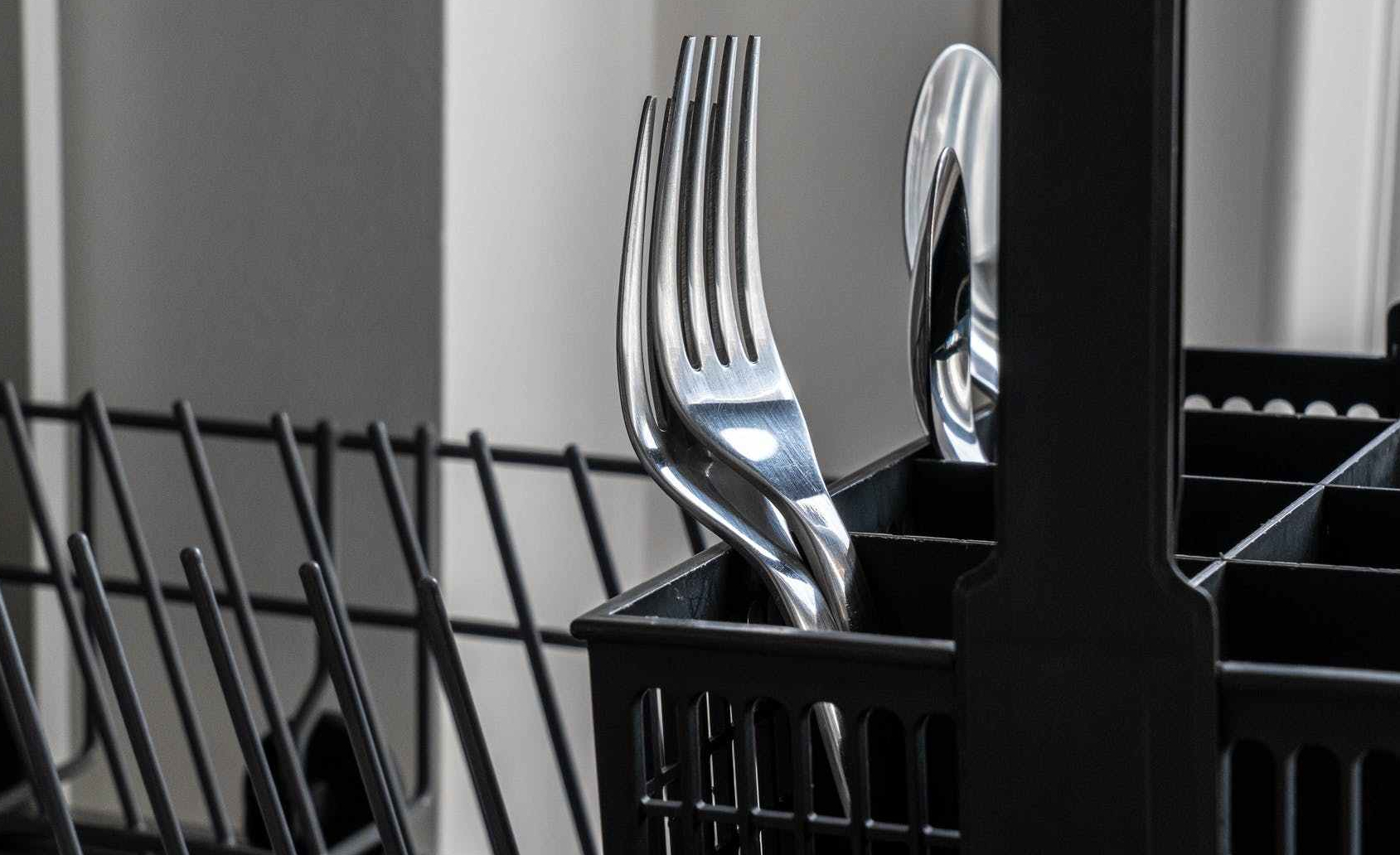 forks and spoons in a dishwasher