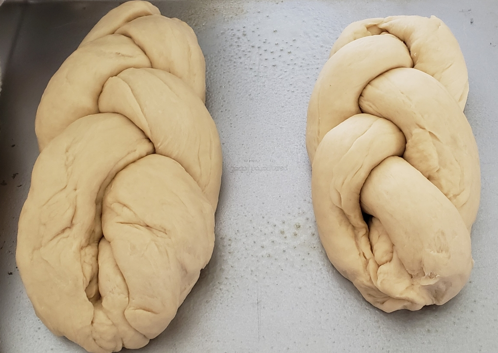 braided loaves on the pan