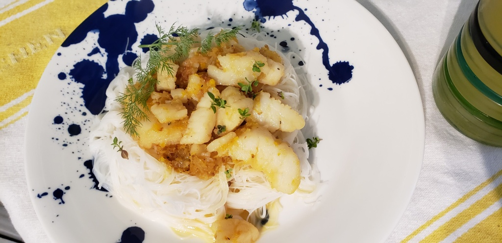 finished coconut, lemon and ginger scallops on rice noodles
