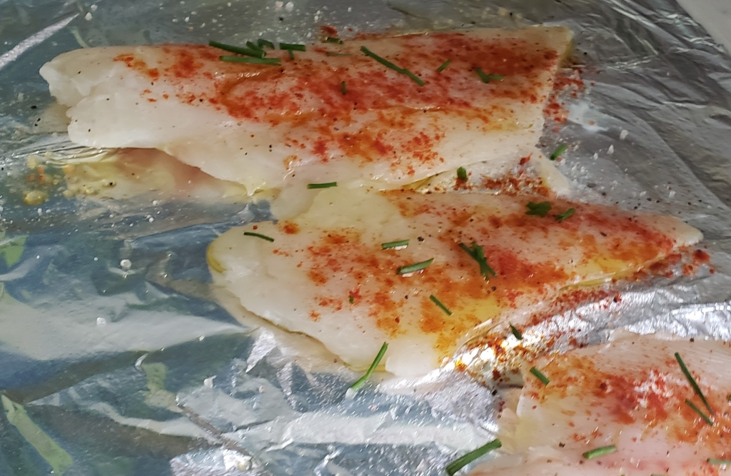 fish filets drizzled with olive oil, and sprinkled with herbs and spices