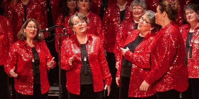 Fever Pitch singing in red sequined jackets