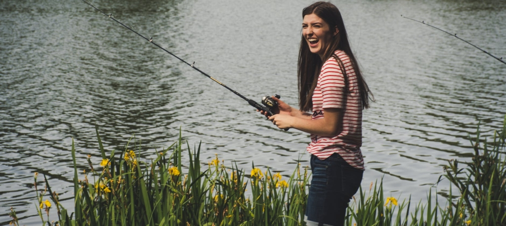 Smiling girl fishing