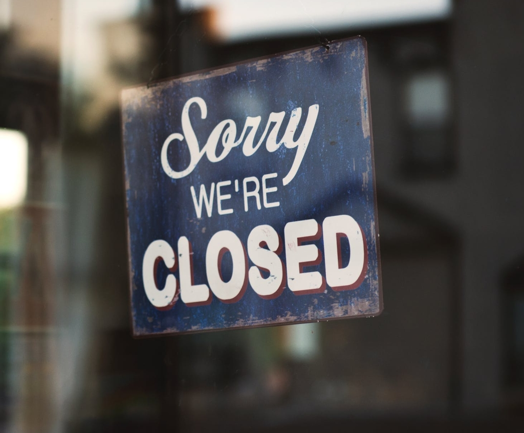 Store sign stating they're closed.