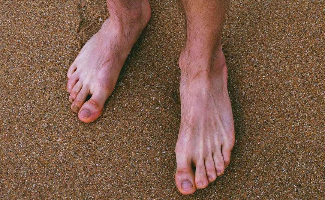 man's bare feet