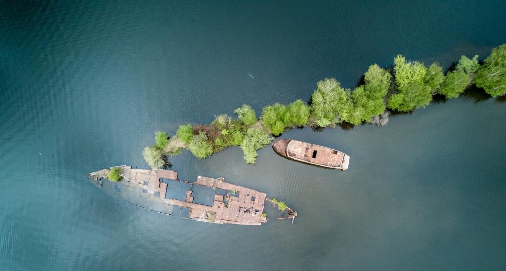 shipwrecked boats on a tiny island
