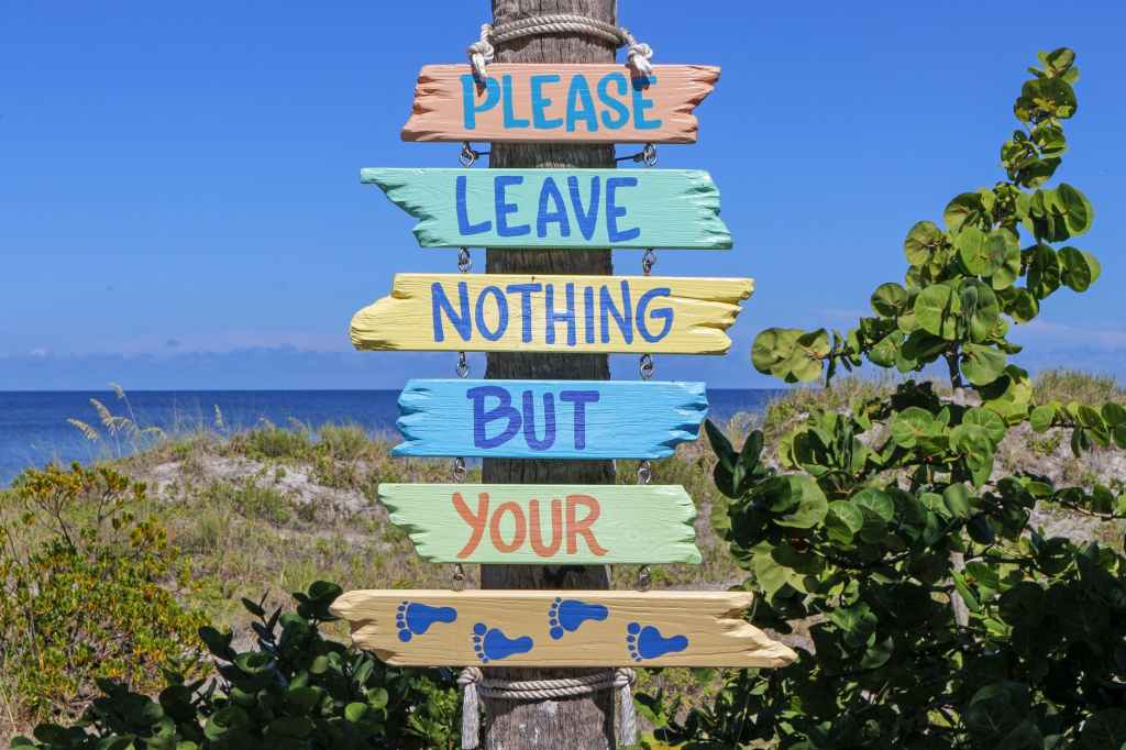 Signs at the beach, Please leave nothing but your footprints