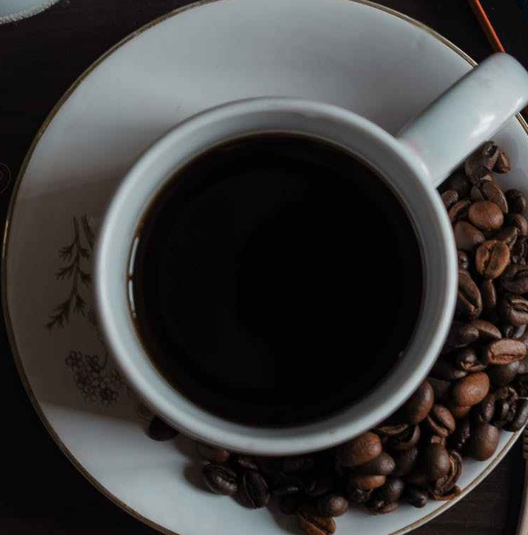 cup of coffee with beans.