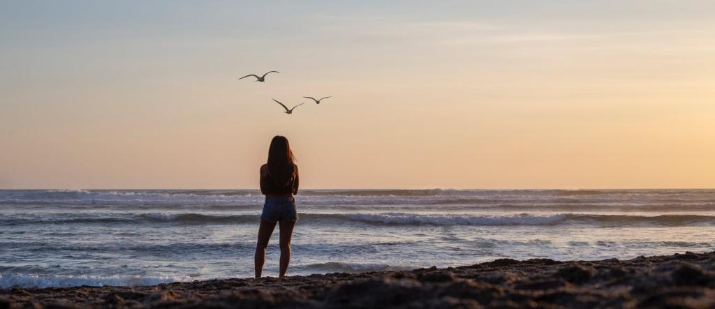 young girl watching the ocean