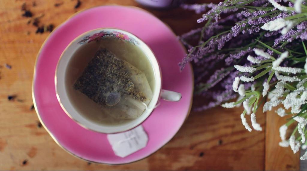 tea cup on a pink saucer
