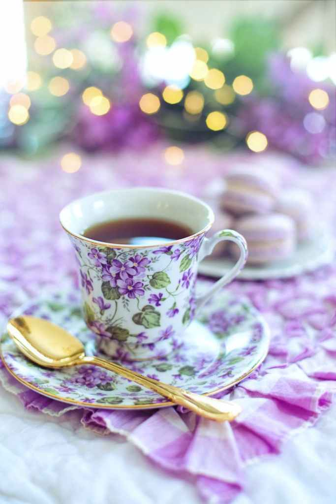 violet covered tea cup with gold spoon