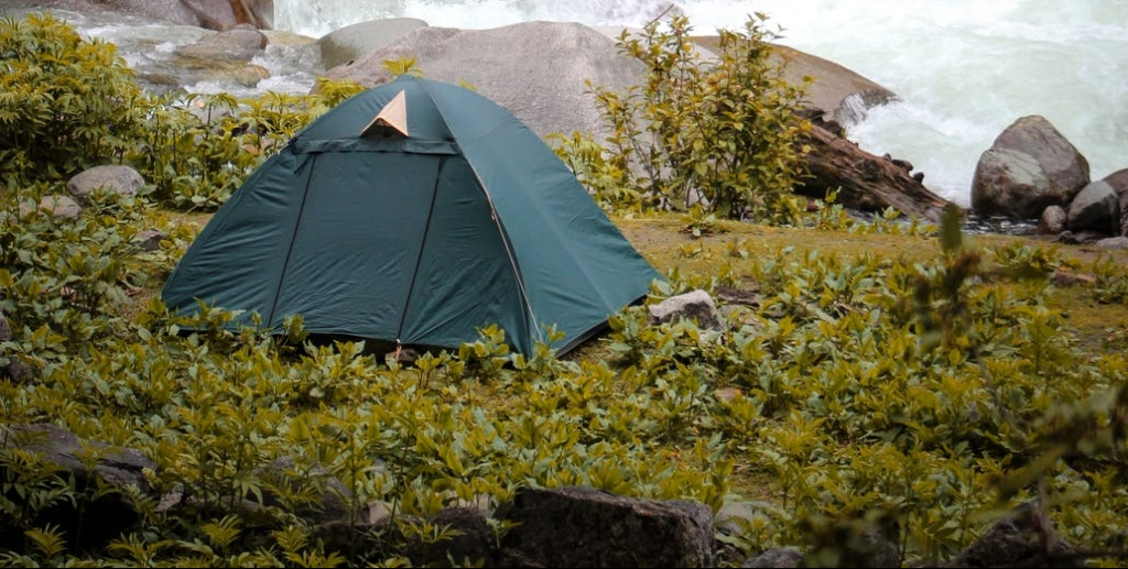 tent pitched near rocks.