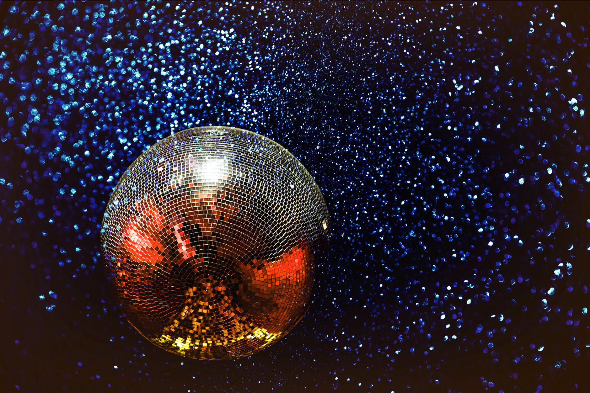 disco ball against sparkly background