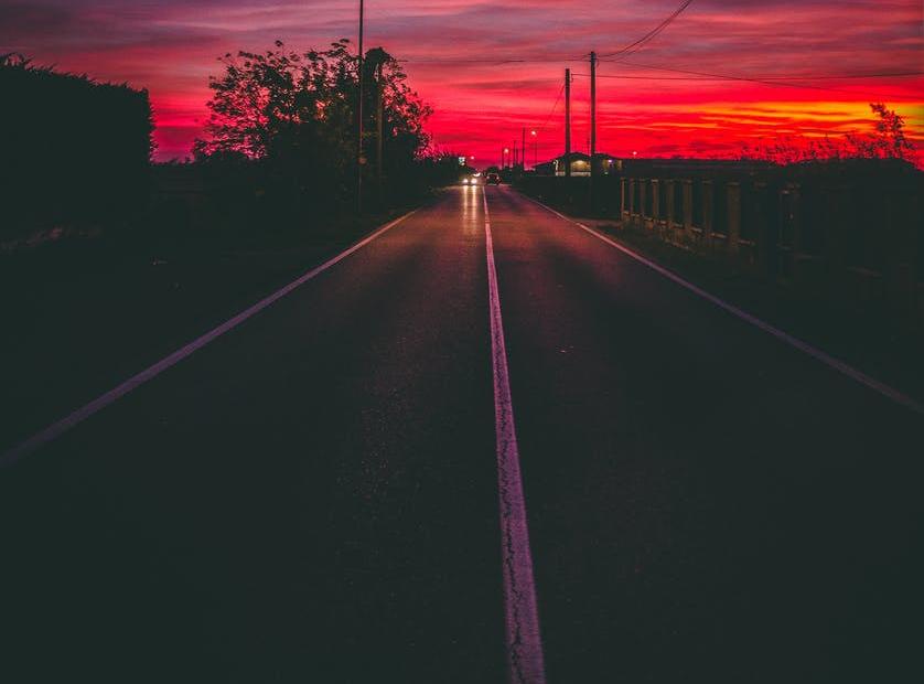 a car driving down a dark road