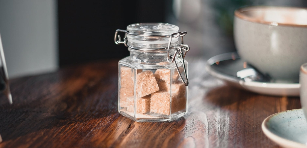 a small jar of coffee flavored sugar cubes