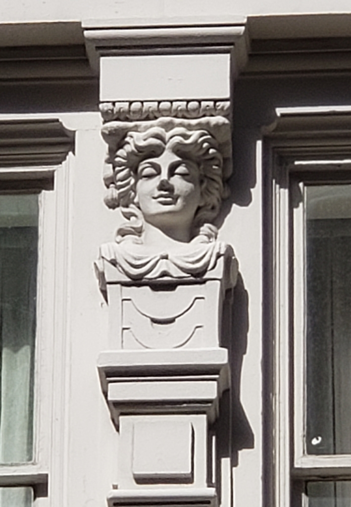 A stone carving on one of the buildings near our hotel