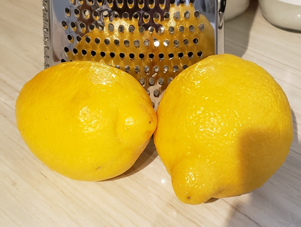 two lemons in front of my favorite grater