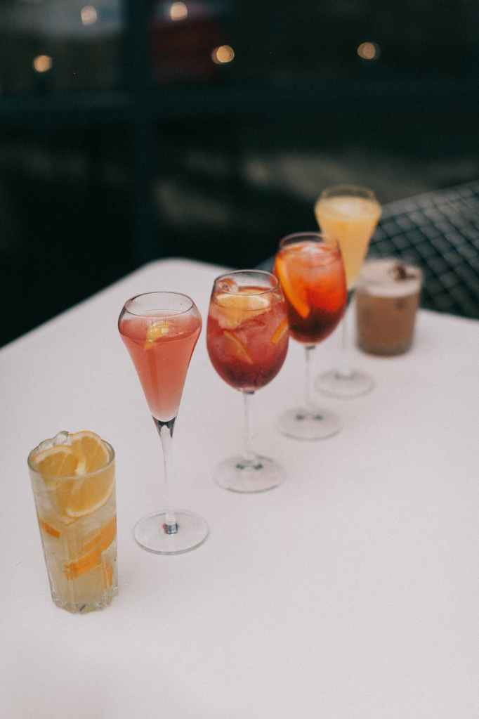 mixed drinks lined up at the table.