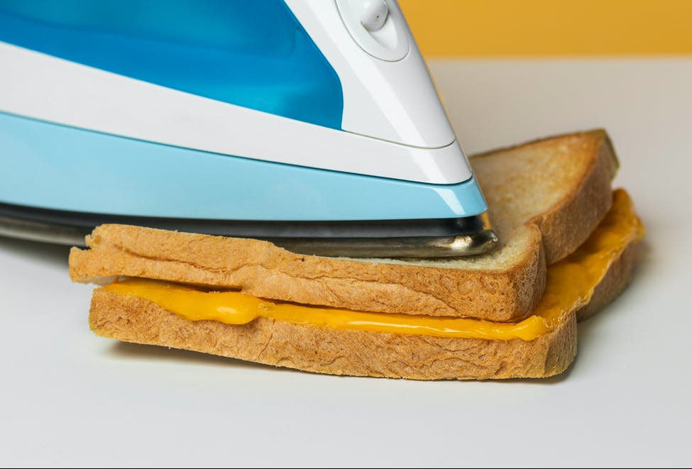 making a grilled cheese with an iron