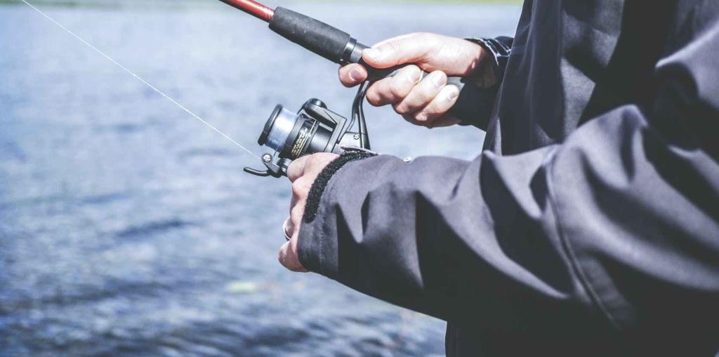 Man reeling in a fishing rod