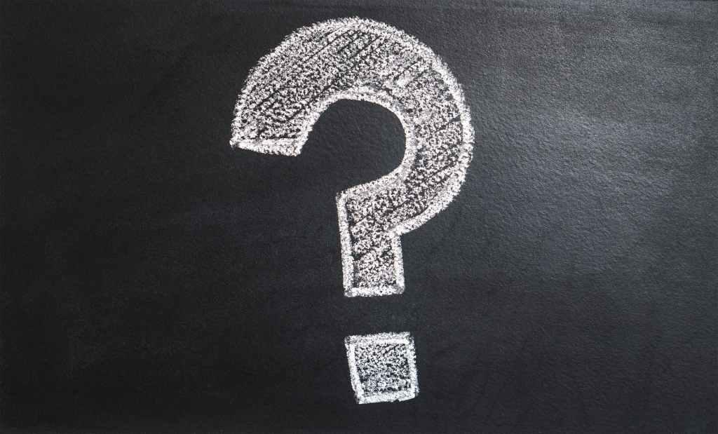 chalk question mark on a black board.