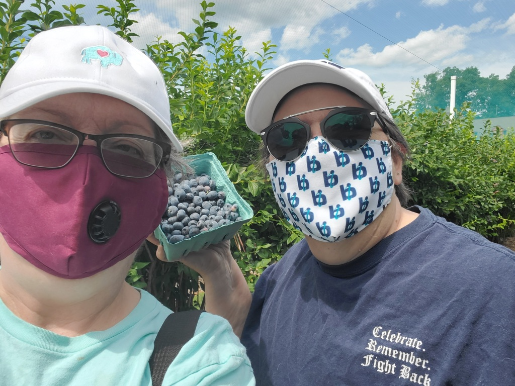 Beth and I in masks, out in the blueberry fields
