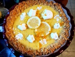 Final pie with whipped cream, lemon slices and lemon and orange zest