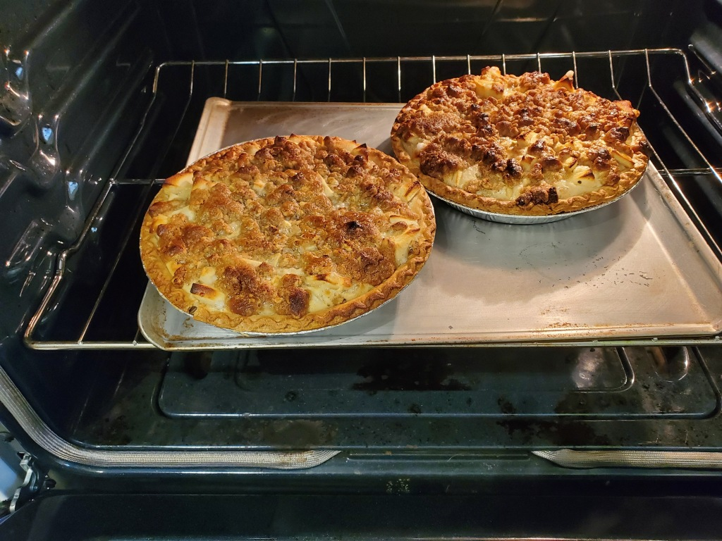Two pies baking in the oven