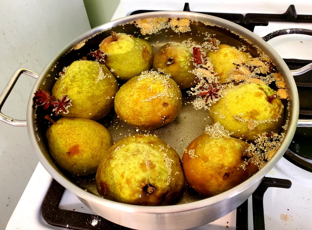 pears simmering in their spicy bath