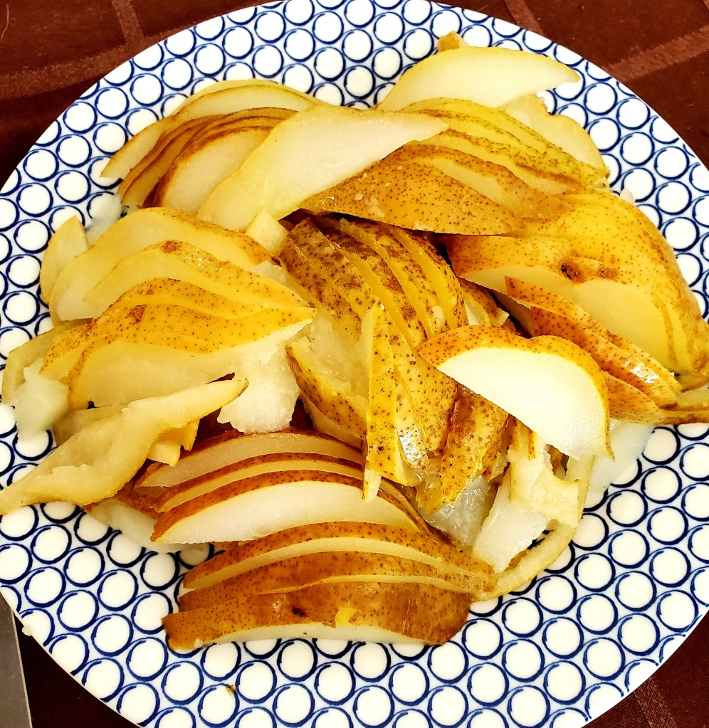 sliced pears after being boiled in spiced water