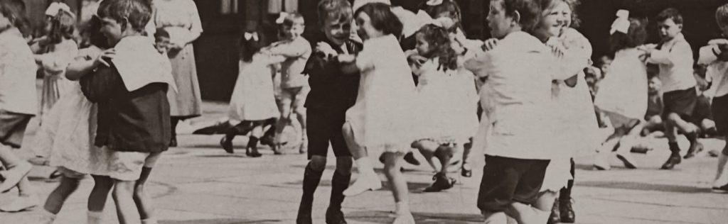 old photo of kids dancing on the playground