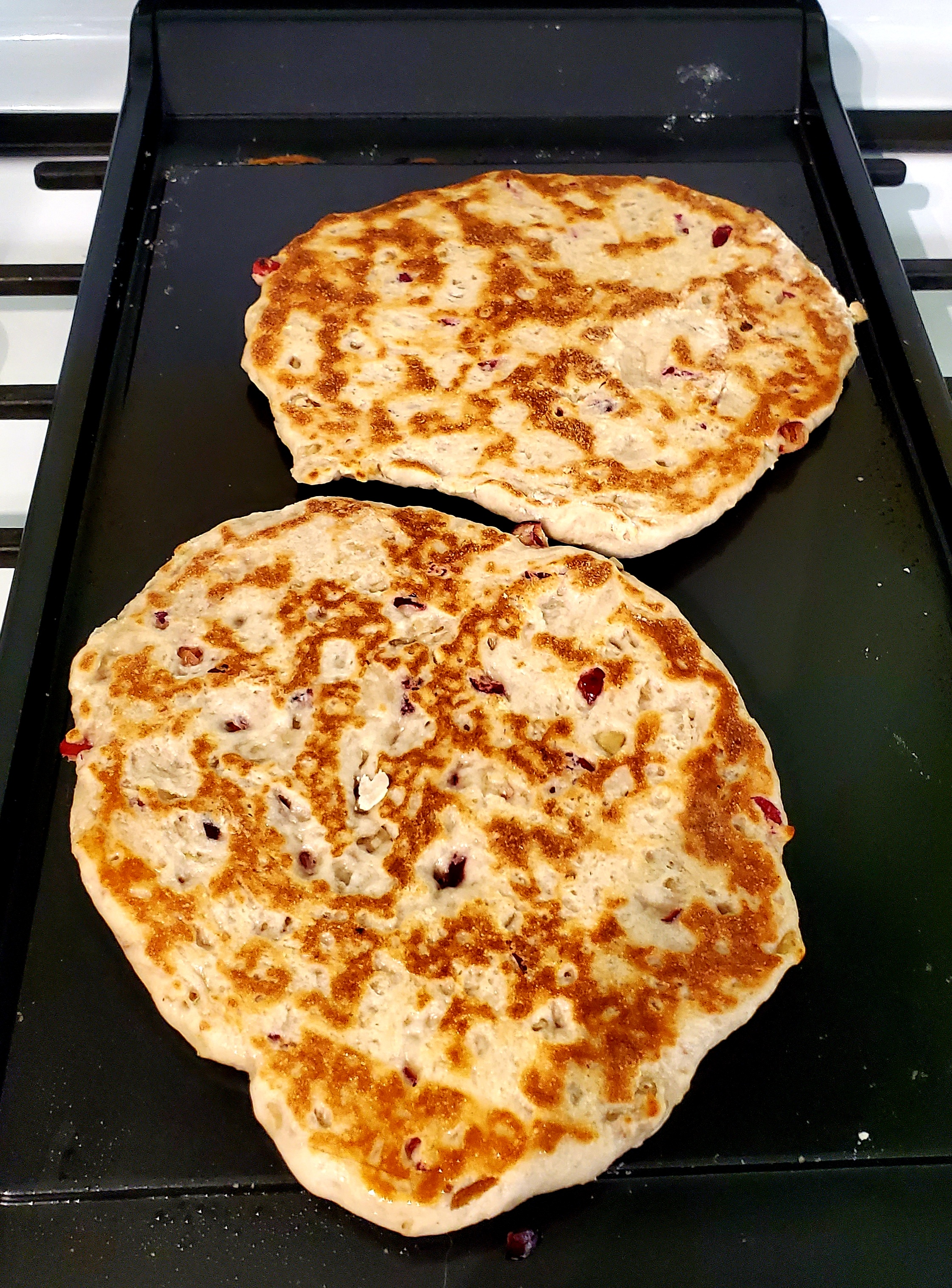 Two naans browned on top