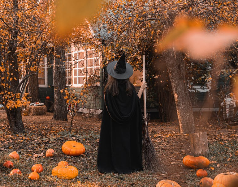 Witch gazing at a house