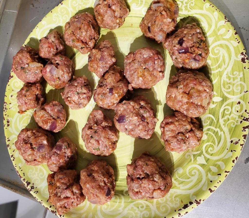 Meatballs on a plate pre-flour