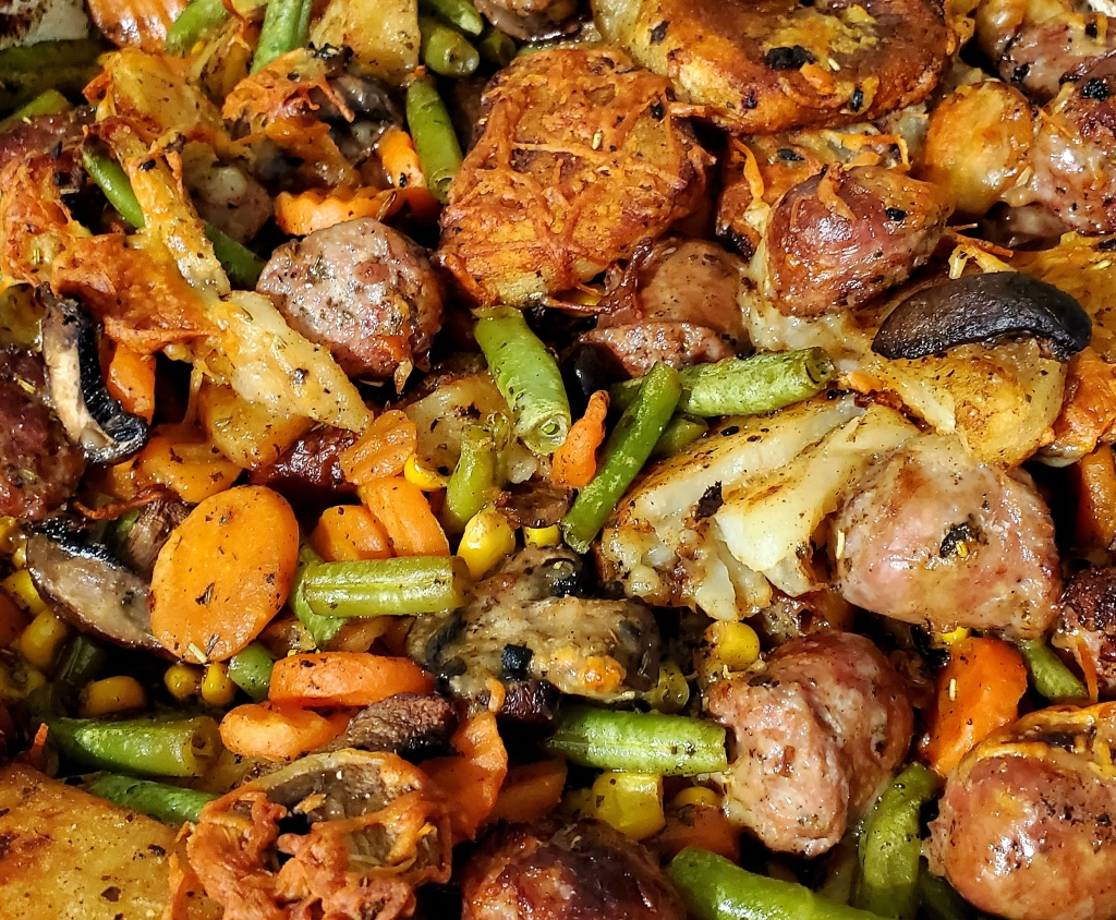 Baked sausage and potatoes with a selection of vegetables