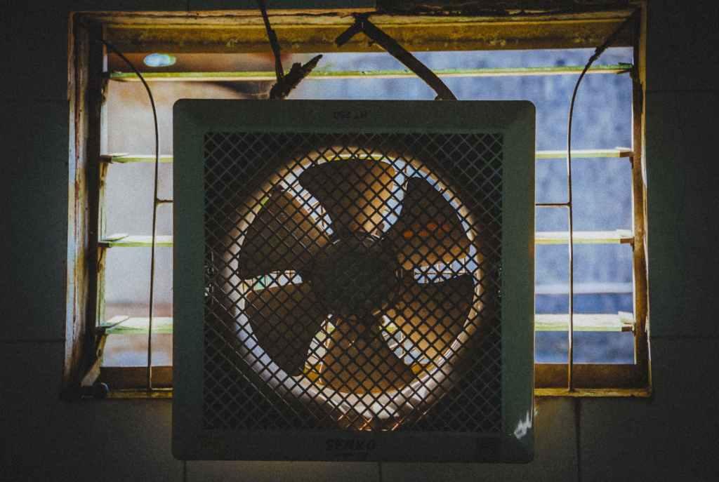 box fan hanging in the window