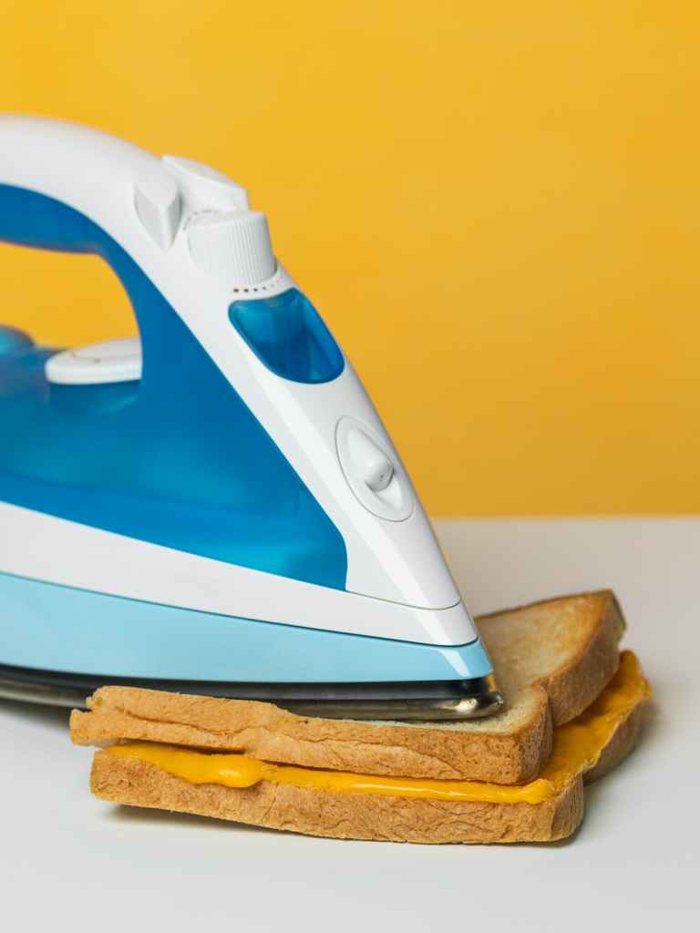 Making grilled cheese with an iron