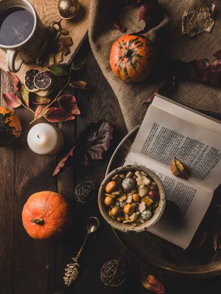 Autumn leaves, dried fruit, and a cup of tea