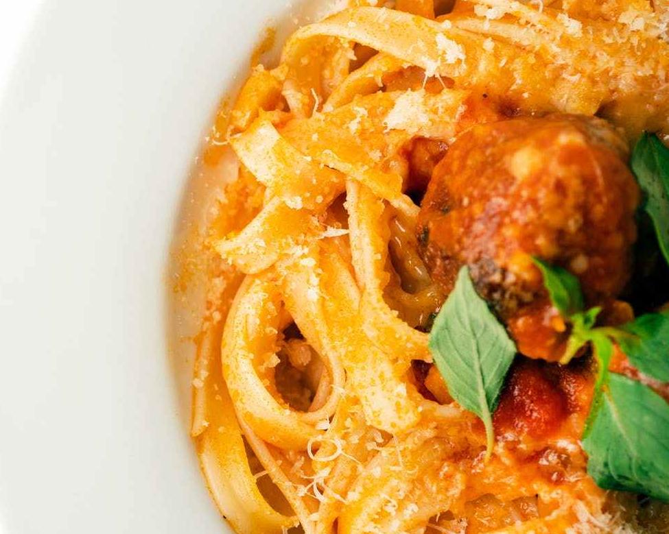 closeup of meatballs on pasta