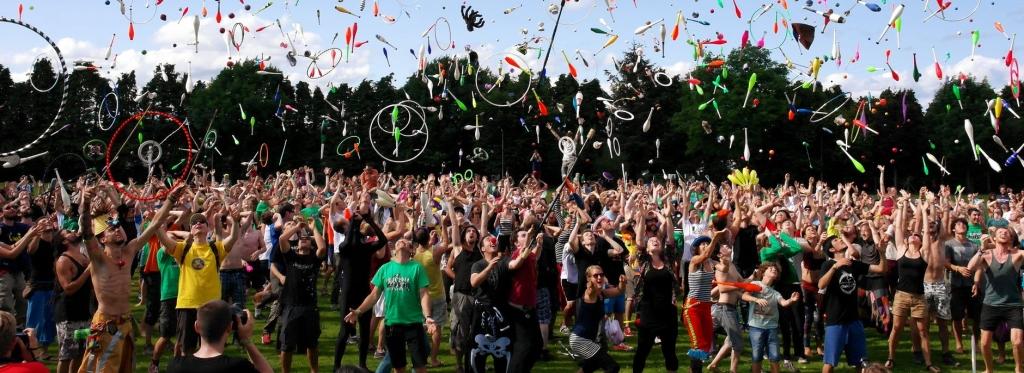 crowd of people throwing things in the air.