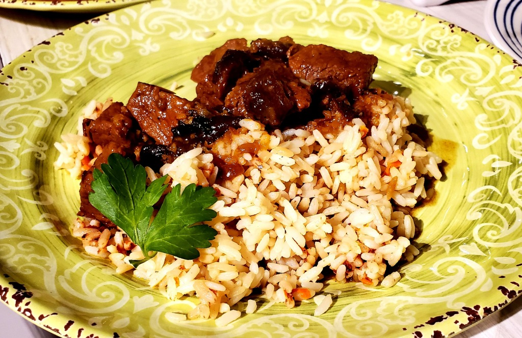 Plate of lamb tagine with citrus basil rice