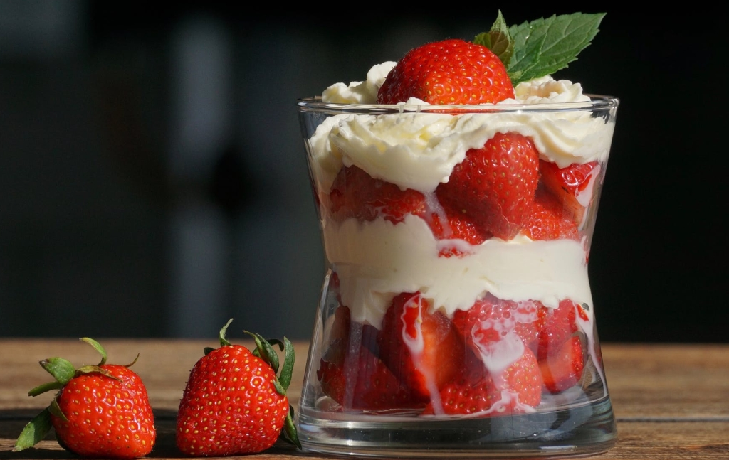 Straweberries with cream in a glass