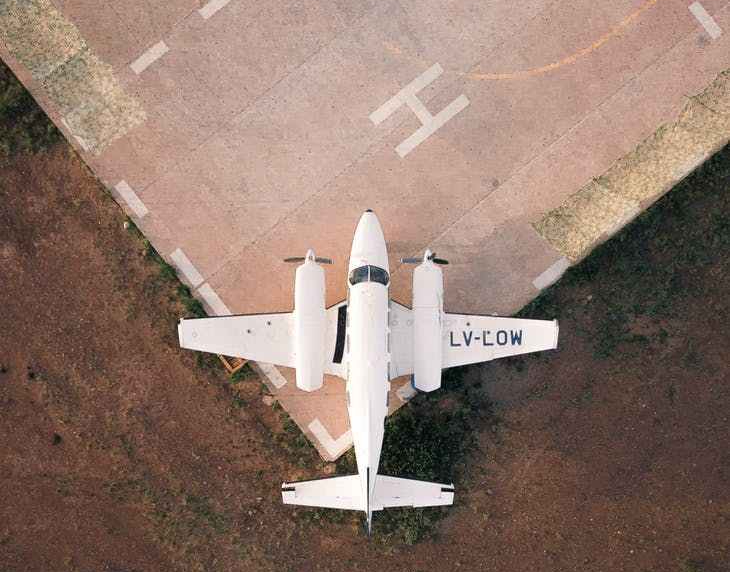 small plane on a runway/helipad