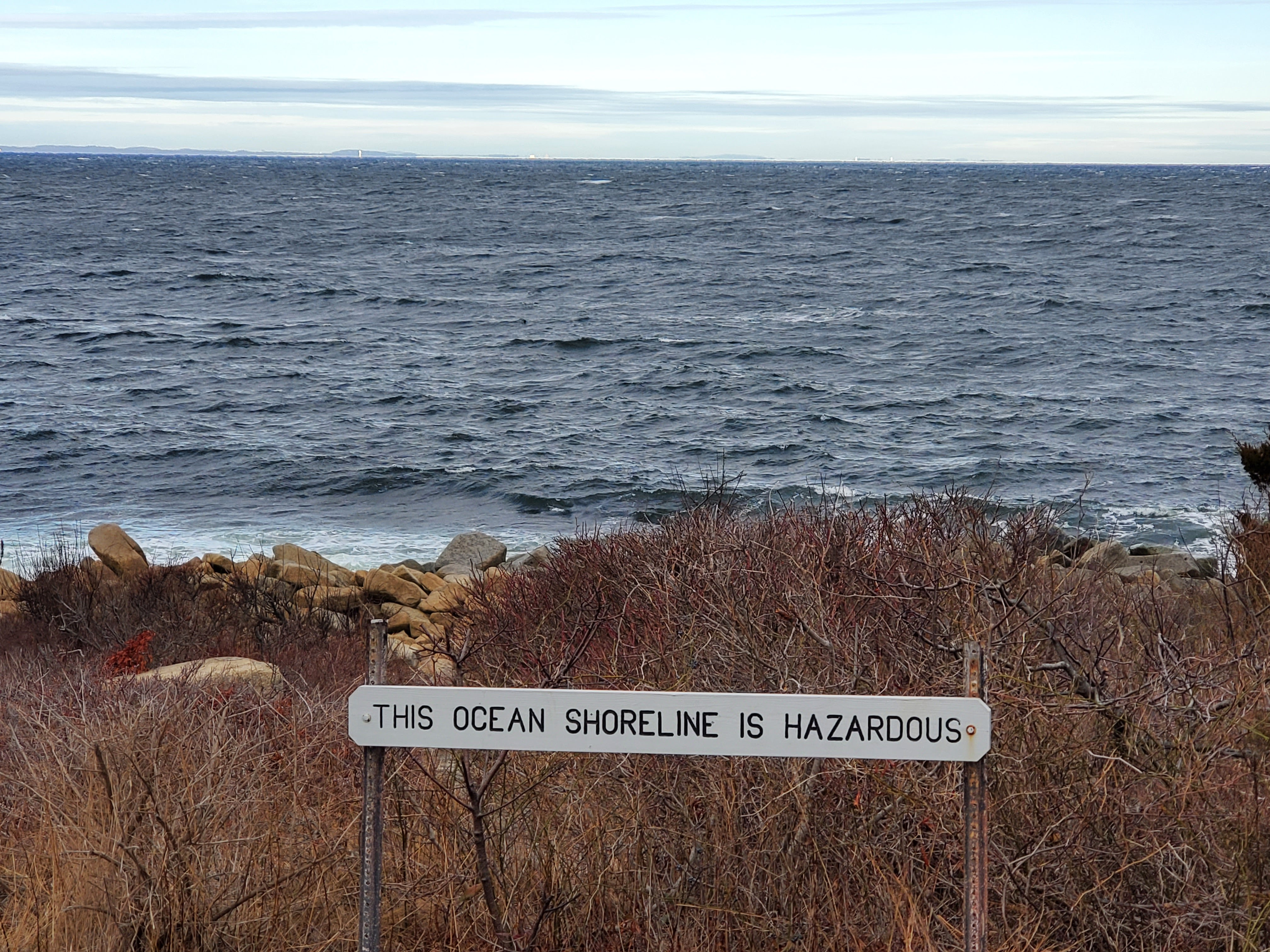 "Sign stating ""This Ocean Shoreline is Hazardous"""