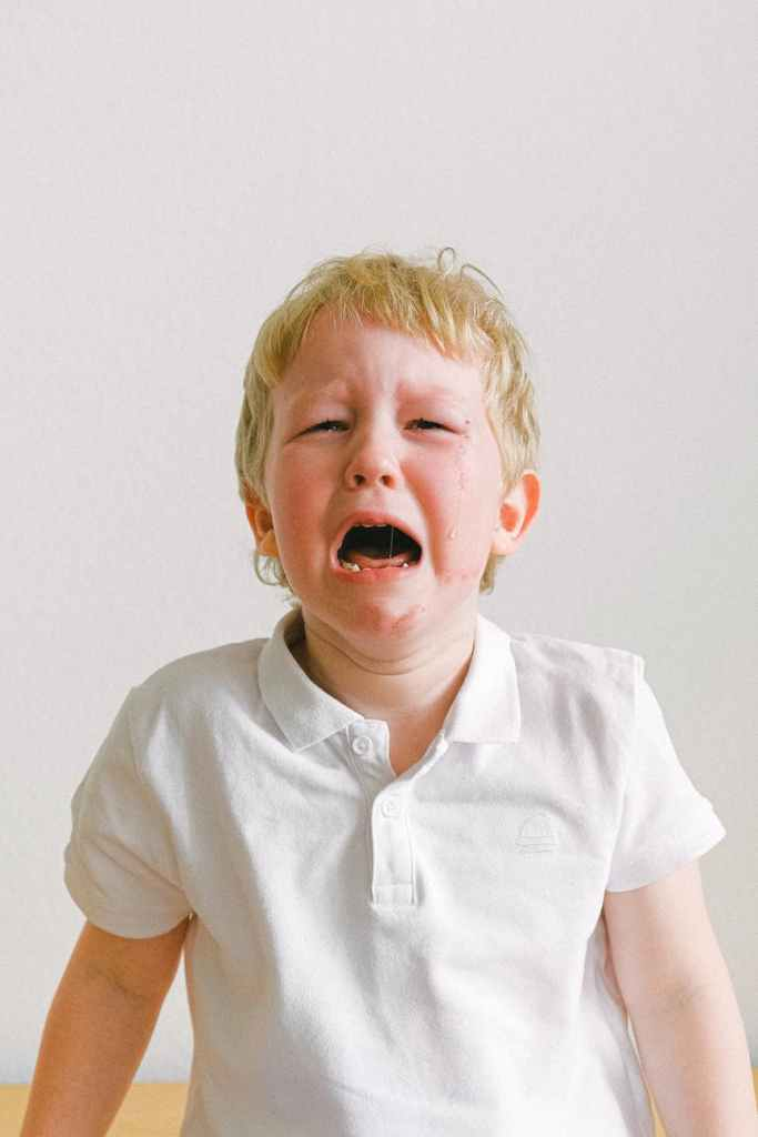 Little blonde boy crying