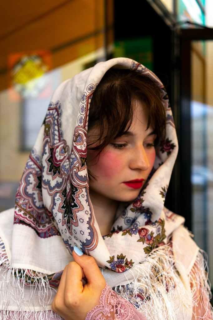 Young woman wearing head shawl